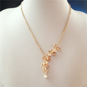collier mariage orchidee doré